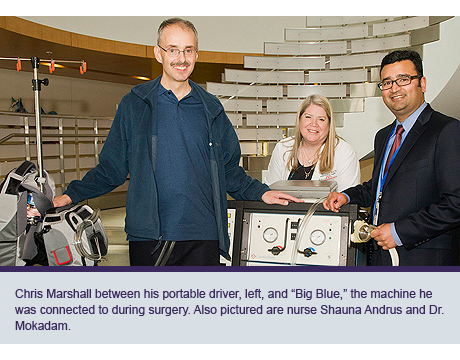 "Chris Marshall between his portable driver, left, and ""Big Blue,"" the machine he was connected to during surgery. Also pictured are nurse Shauna Andrus and Dr. Mokadam."