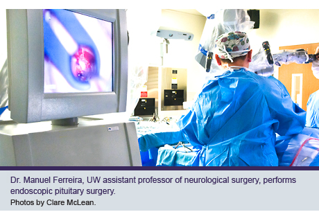 Dr. Manuel Ferreira, UW assistant professor of neurological surgery, performs endoscopic pituitary surgery.