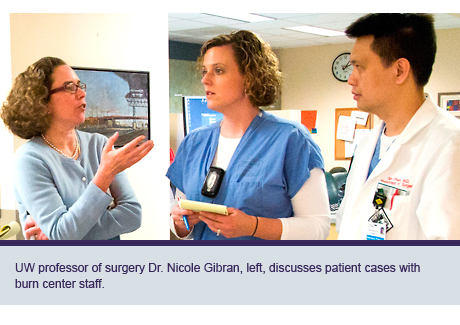UW professor of surgery Dr. Nicole Gibran, left, discusses patient cases with burn center staff.