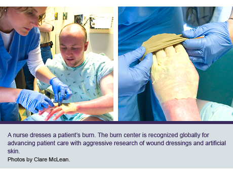 A nurse dresses a patient's burn. The burn center is recognized globally for advancing patient care with aggressive research of wound dressings and artificial skin.